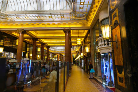 laurent: PARIS, FRANCE - February 20: The : inside part of the famous Mall Lafayette with its brand stands Saint Laurent, Jean Paul Gaultier, Lancome and customers Editorial