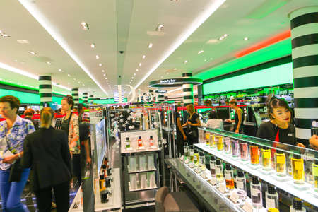PARIS, FRANCE - February 20: The : inside part of the famous Mall Lafayette with it's brand stands Saint Laurent, Jean Paul Gaultier, Lancome and customers Editorial