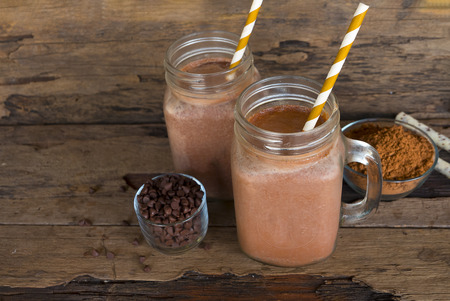 Chocolate and cocoa mixed with milk, smoothies on wooden floor.
