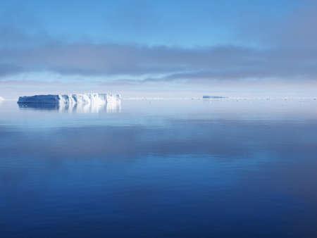 antarctica: Antarctica blue iceberg landscape ocean mirrow reflection