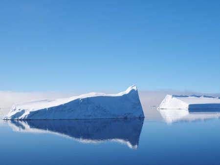iceberg: Antarctica blue iceberg landscape ocean mirrow reflection