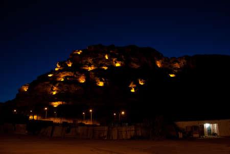 grave site: hill in old town of Al-Ula at nighti n Saudi Arabia
