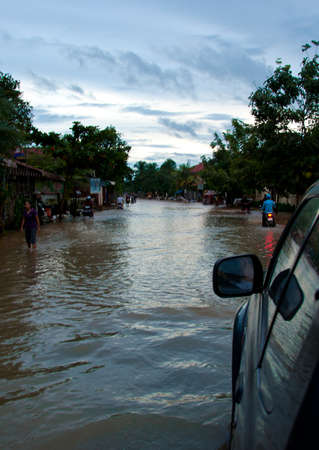 flooded: car passing flooded street in Cambodia