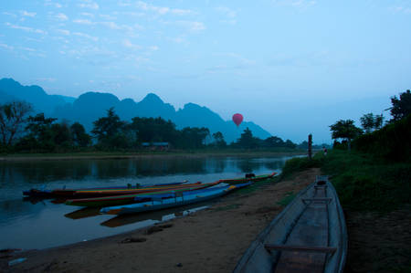 tranquille: Kayaks on Nam Song River at Sunrise in Vang Vieng Laos