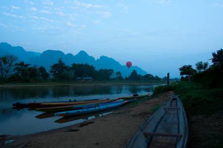 Kayaks on Nam Song River at Sunrise in Vang Vieng Laos