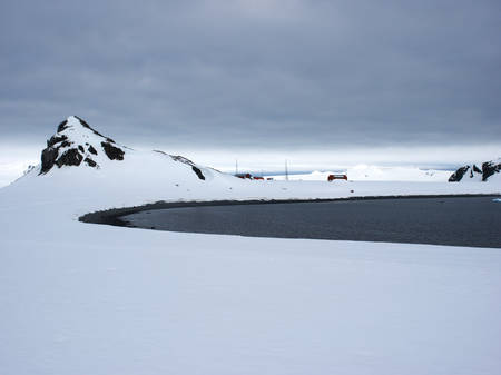 weddell: Argentinian research station covered in snow in the distance on Halfmoon Island Antarctica