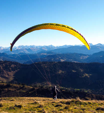 paraglider: Paraglider in the Bavarian Alpes in front of mountain panorama and blue sky