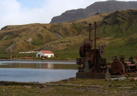 blubber: Panorama of Grytviken with old factory buildings, cemetery and green hills in South Geoergia Stock Photo