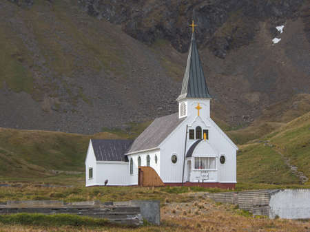 blubber: Norwegian church and hills on Christmas day in former old whaling station Grytviken, South Geoergia