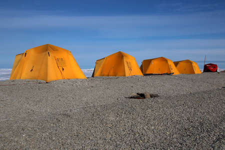 C&ing in orange tents in Canadian Arctic landscape photo & Camping In Orange Tents In Canadian Arctic Landscape Stock Photo ...
