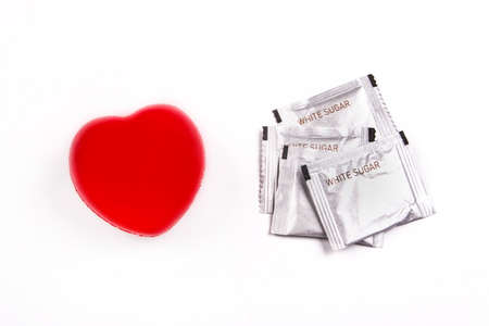 White sugar and heart isolated on a white background