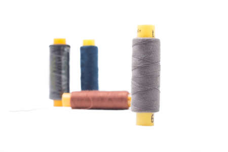 Thread coils isolated on white background, sewing kit.
