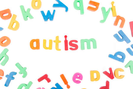Autism text with scattered alphabets isolated on a white background.