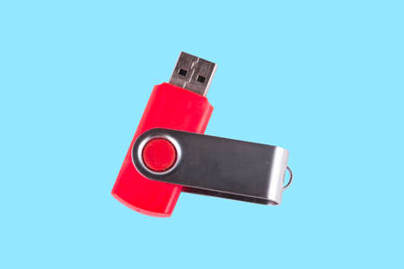 Universal serial bus USB drive isolated over blue background. Stock Photo