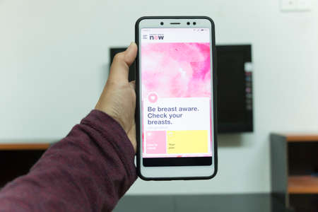 Negeri Sembilan, Malaysia - August 30, 2018: Breast Cancer Now application on smartphone. It is a breast health application dedicated for every womans phone.