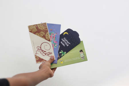 Money packet as Hari Raya gift for Ramadan and Eid al-Fitri Celebration. Salam Aidilfitri text in Arabic and Malay translated in English as Eid al-Fitr