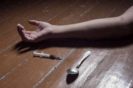 suffusion: Hands addict with syringe to inject a drug Stock Photo