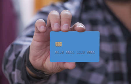 Hand with credit card.  photo