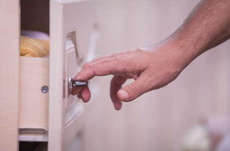 closet door: open closet door, male hands opening closet door
