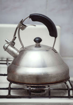 old gas stove: old kettle on the old gas stove