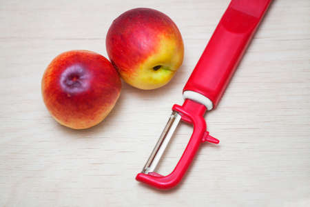paring: two peach and cleaning the knife on the Board