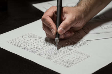 male hand holding a pen and looking project Stock Photo