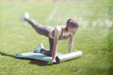Girl does yoga on the grass Stock Photo