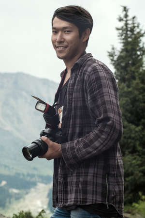 A guy with a camera outdoor