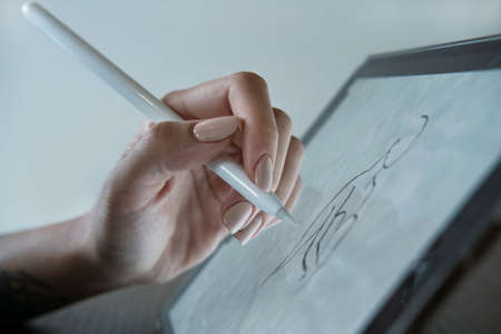 Female hand draws on a graphics tablet Stok Fotoğraf