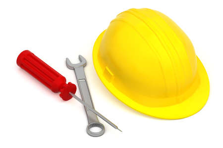 work tools and hardhat isolated on white background - screwdriver and wrench near a yellow worker hat photo
