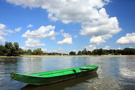 a green boat in the river  photo