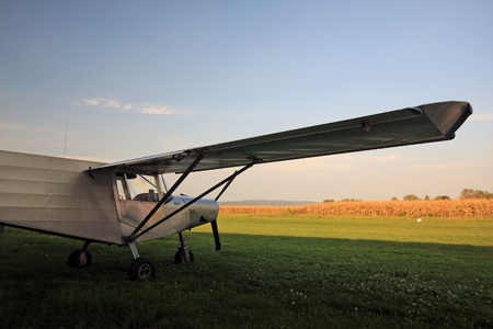 fixed wing aircraft: Airplane in a grain field
