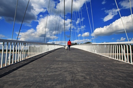 a man and a dog are walking on the bridge  Stock Photo - 8610531