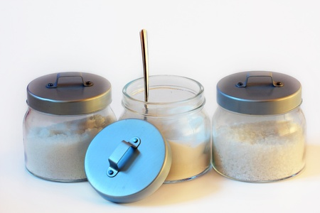 three jars of sugar and salt with white background