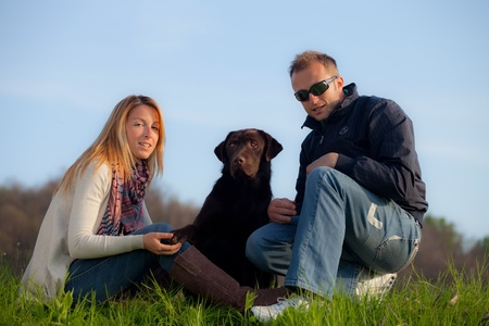 young couple with dog in the park  photo