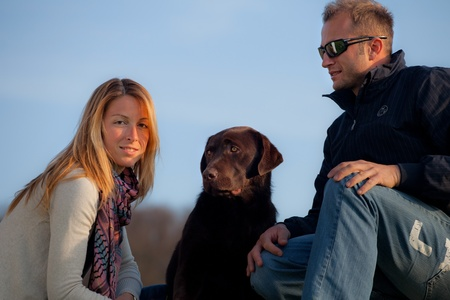 pic nic: young couple with dog in the park  Stock Photo
