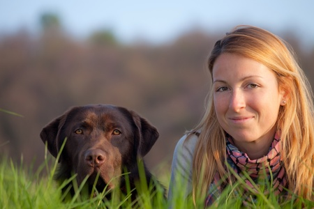 young woman and labrador dog