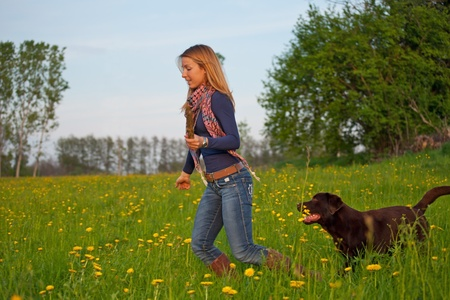 young girl run in the park with a dog Stock Photo - 13230664