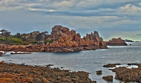 Pink granite near Perros Guirec, France  Stock Photo - 13813180
