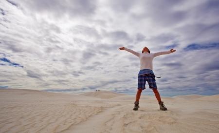 Woman in sand dunes in Lancelin, Australia