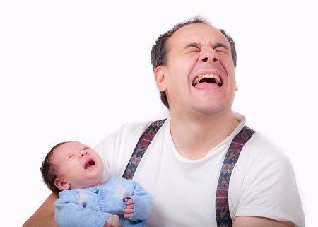 Bambino dolce ragazzo cryes con il padre Archivio Fotografico