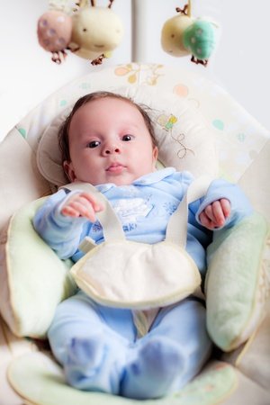 sweet baby seated on a rocking chair Standard-Bild