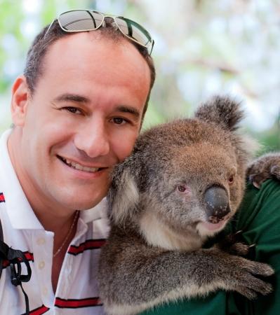 Man with sweet koala in western Australia