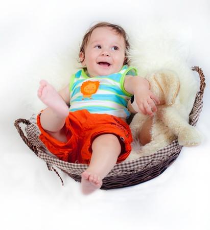 sweet baby in a wicker basket  Stock Photo
