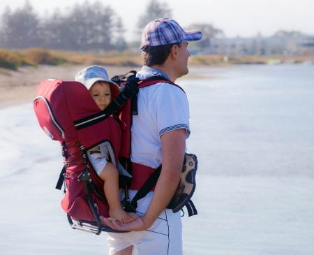 Dad and baby in a backpack