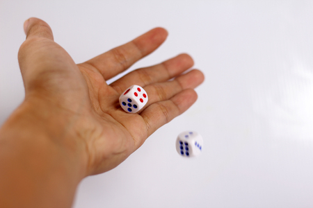 hand throwing two dice photo
