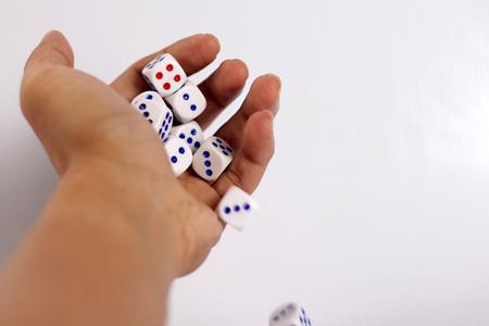 hand throwing dice photo