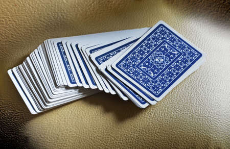 disintegration: The disintegration of a deck of cards with a blue pattern