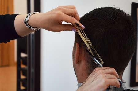 women's hands: womens hands hairdresser cutting hair male hair salon Stock Photo