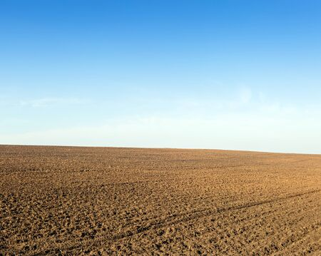 plowing: Plowed field for planting winter crops a clear autumn day. Stock Photo